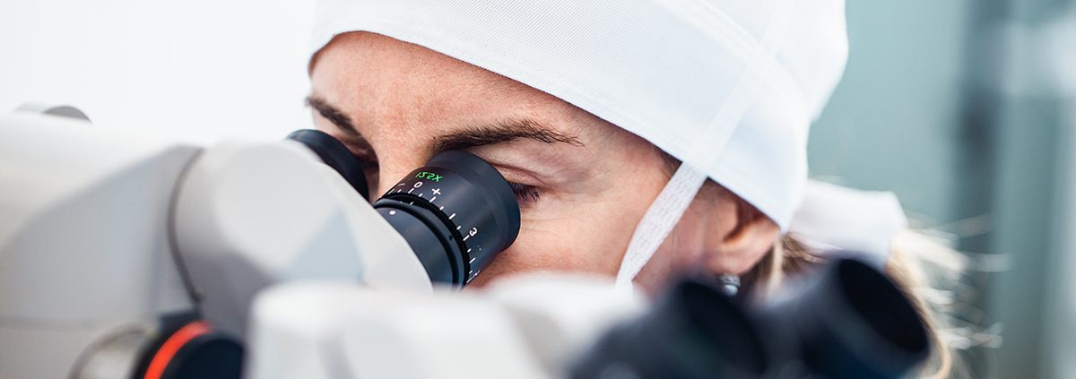 Doctor using microscope during eye surgery process, treatment of