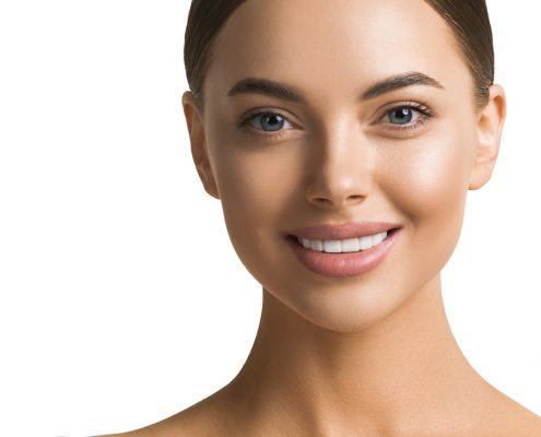 Beautiful teeth smile woman face healthy skin and teeth isolated on white